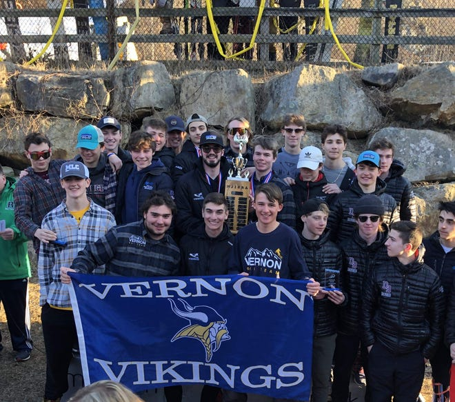 The Vernon boys ski team, center, celebrates its state title on Feb. 24 at Mountain Creek Resort in Vernon.