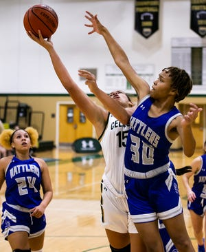 Trinity Catholic's Rose Gravel goes in for a layup against Belleview's Zakiya Scruggs. Trinity Catholic defeated Belleview, 51-45, Wednesday night.