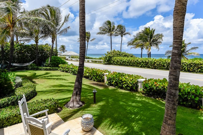 With an ocean view across the coastal road, a Palm Beach house at 1285 N. Ocean Blvd. has sold with an adjacent home for a combined $12.1 million, the just-recorded deeds show.