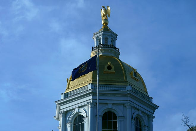 The rising sun illuminates the Statehouse dome, Thursday, Jan. 7, 2021, in Concord, N.H.