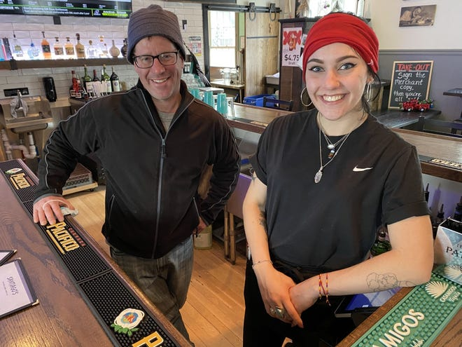 Santiago's bartender Bella Testa and owner Andy DeBenedictis inside the restaurant, which opened in July amid the COVID-19 pandemic.