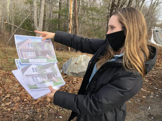 Sarah Dore, of the Kennebunkport Heritage Housing Trust, points out where various new, affordable homes will be built on Main Street in 2021.