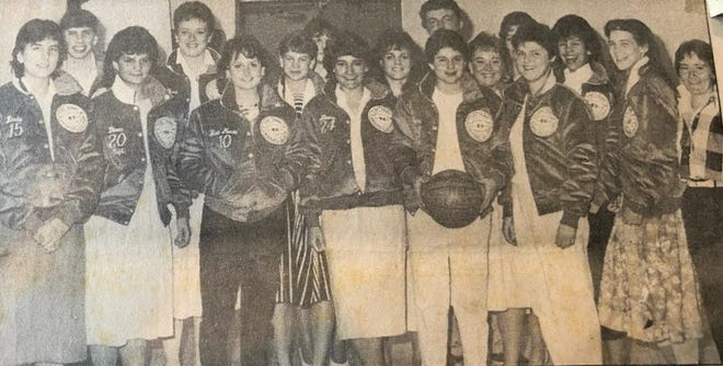 The Somersworth High School girls basketball team is pleased as punch to be wearing their 1985-86 Class I championship jackets, signifying the school's first girls' hoop title.