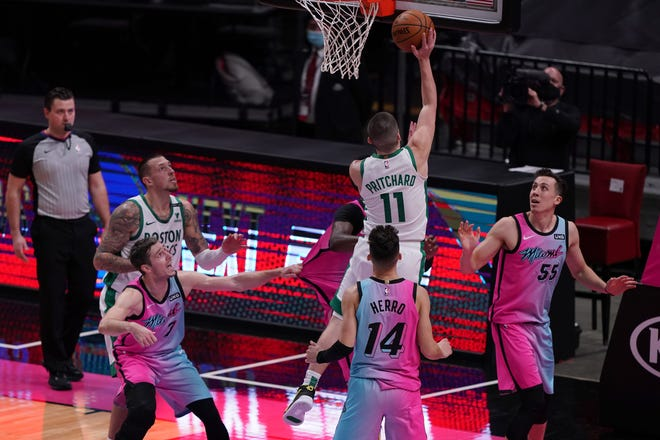 Jan 6, 2021; Miami, Florida, USA; Boston Celtics guard Payton Pritchard (11) shoots the game winning basket against the Miami Heat during the second half at American Airlines Arena. Mandatory Credit: Jasen Vinlove-USA TODAY Sports