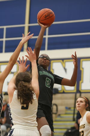Aurora senior Shyanne Sellers goes up for a shot during Wednesday night's game against Copley High School.