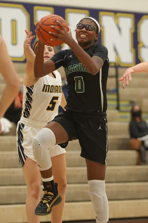 Aurora senior Shyanne Sellers drives to the basket during Wednesday night's game against Copley High School.