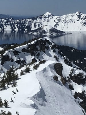 A view of Crater Lake and Wizard Island as seen from Mount Scott.