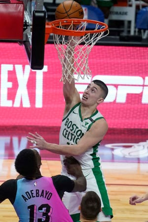 Payton Pritchard scores the game-wining basket for the Boston Celtics in their 107-105 win at the Miami Heat on Wednesday.