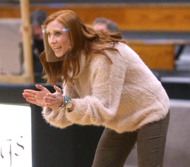 Hoover's Abbey Allerding coaches her team during a Jan. 6, 2021 game against McKinley in North Canton. Allerding stepped down as the Vikings girls basketball head coach on Monday.
