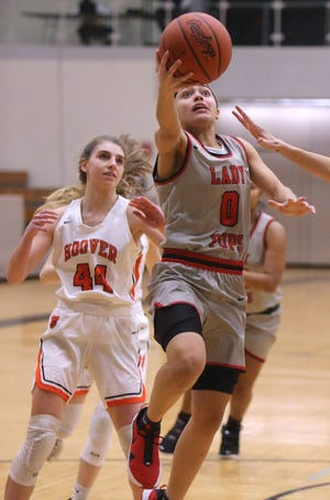 Nakyah Terrell (0) of McKinley goes to the basket while being trailed by Grace Craig (44) of Hoover during their game on Wednesday.