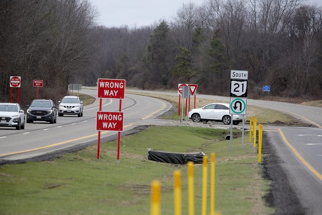 A car uses the Butterbridge restricted crossing U-turn heading south on state Route 21 in Lawrence Township. The Ohio Department of Transportation says the turns restrict motorists traveling across the four-lane highway, improving safety.