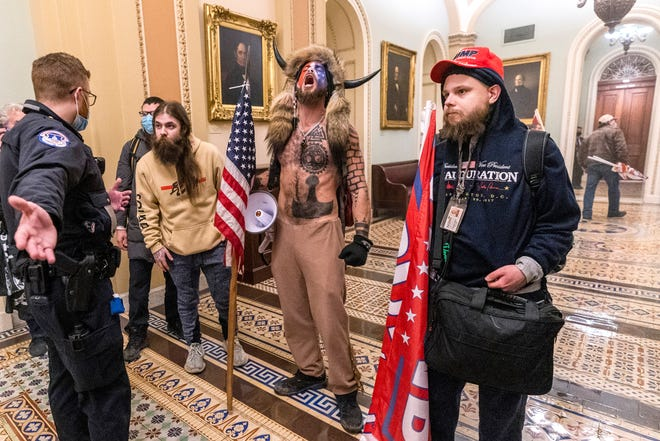 Supporters of President Donald Trump are confronted by Capitol Police officers outside the Senate Chamber on Wednesday. After the violence at the Capitol, and as Trump's presidency comes to a close, some are asking where the GOP goes next.
