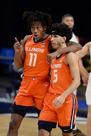 Illinois' Ayo Dosunmu (11) and Andre Curbelo (5) make their way up the court late in the second half against Penn State on Wednesday, Dec. 23, 2020, in State College, Pa. [Gary M. Baranec/The Associated Press]