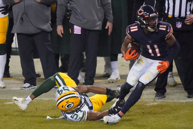 Green Bay Packers' Kamal Martin tries to stop Chicago Bears' Darnell Mooney on Sunday, Jan. 3, 2021, in Chicago.