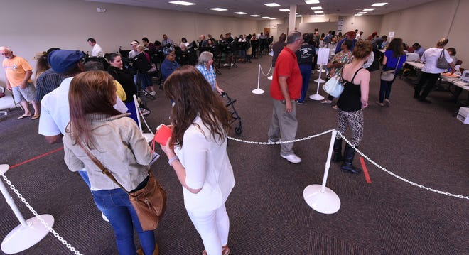 Voters line up to cast their vote during early voting at the Hew Hanover County Government Center in Wilmington, N.C. Nov. 1, 2016.