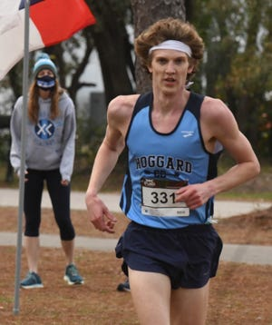 The Hoggard boys and girls swept the Mideastern Conference Cross Country Championships, while Hoggard's Andrew Thompson came in 1st place for the boys and Topsail's Kaitlyn Obremski came in 1st place for the girls Thursday Jan. 7, 2021 at Long Leaf Park in Wilmington, N.C. [KEN BLEVINS/STARNEWS]