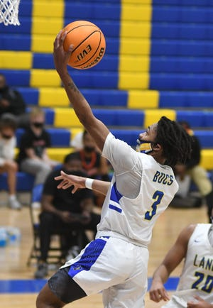 Laney's Kyvious Berry drives to the basket against New Hanover at Laney Wednesday, January 6, 2021. The game was the season opener for both teams. [MATT BORN/STARNEWS]
