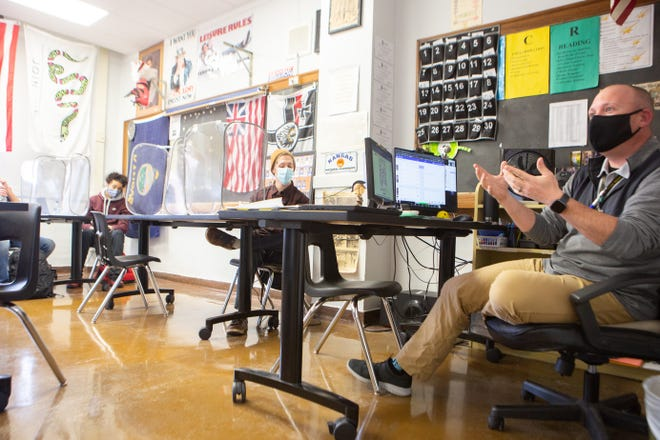 Ryan Nelson, U.S. government teacher at Topeka High School, lectures his students Thursday over the events of Wednesday in Washington, D.C.