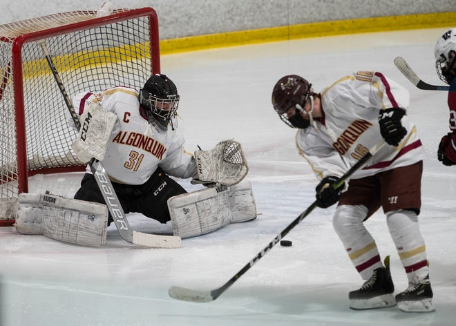 Algonquin goalie Jack Blair protects the net during the season opener against Westboro..