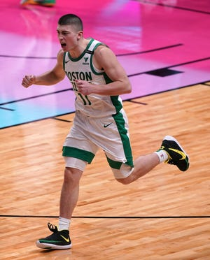 Celtics guard Payton Pritchard celebrates after tipping home the winning basket against the Heat on Wednesday night.