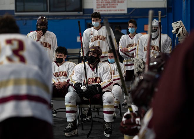 Algonquin teammates listen in following the first half of the season opener against Westboro on Wednesday.
