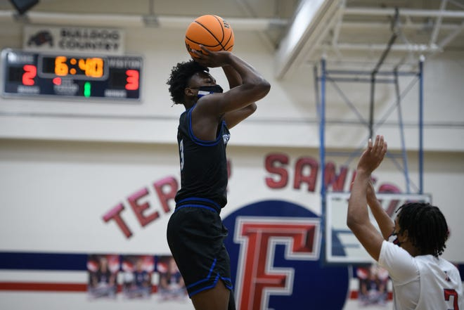 Westover's D'Marco Dunn puts up a shot at Terry Sanford during a boys' basketball game on Wednesday, Jan. 6, 2021.