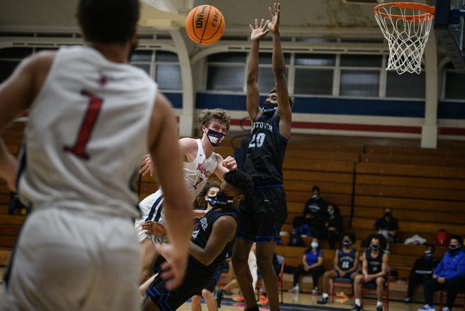 Terry Sanford's Davis Molnar, seen here attempting to pass the ball, notched a triple-double performance in the Bulldogs' 52-47 win against Westover on Wednesday night in the 2021 season opener.
