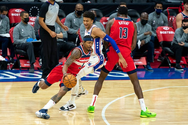 Washington Wizards guard Bradley Beal, left, makes his move on Philadelphia 76ers guard Matisse Thybulle, center, while using center Thomas Bryant, right, as a screen during the first half Wednesday.
