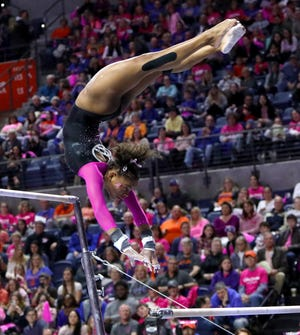 Florida gymnast Trinity Thomas performs her routine on the bars during a meet against Alabama at the Exactech Arena on Feb. 20, 2020. The Gators defeated Alabama to win the regular season SEC championship.