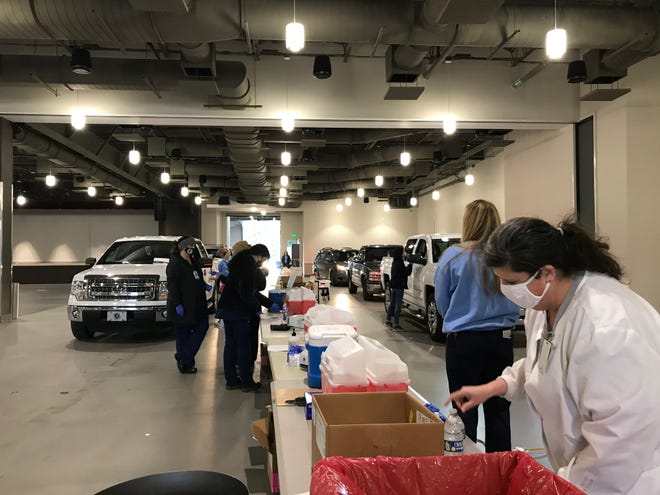 Etowah County Health Department staffers prepare to administer COVID-19 vaccine during a drive-thru clinic Jan. 7 at The Venue at Coosa Landing.
