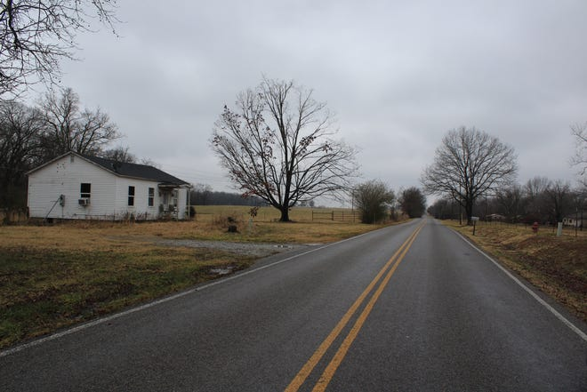 North Mount Olive Road, just outside of Gravette, Arkansas, is seen Thursday, Jan. 7, 2021. Richard Barnett, who posed at Nancy Pelosi's desk during a riot at the Washington, D.C. Capitol Building on Wednesday, Jan. 6, 2021, was last listed living on the street, according to records obtained by USA Today.