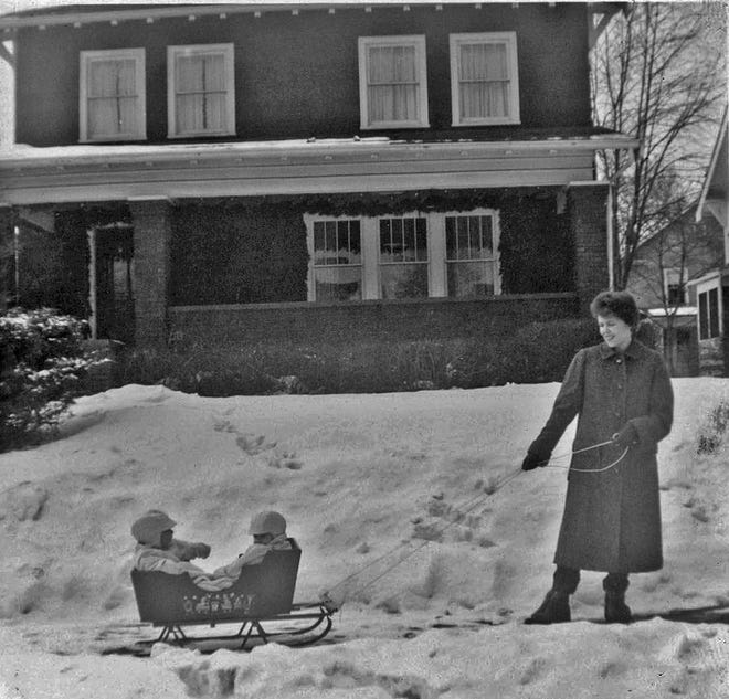 The Looker family owned this home at 1179 Broadview in Grandview Heights for 40 years, beginning in 1950. This 1961 photograph shows the Looker daughter, Elaine, pulling toddlers in a sled in front of the home, which was featured in the Grandview Heights/Marble Cliff Historical Society Tour of Homes in 2010. Elaine died in May 2020.