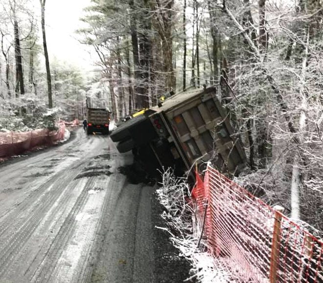 Rochester Fire Dept. crews were on scene for nearly six hours after this tractor-trailer truck hit the soft shoulder and turned on its side on narrow Old Middleboro Road.