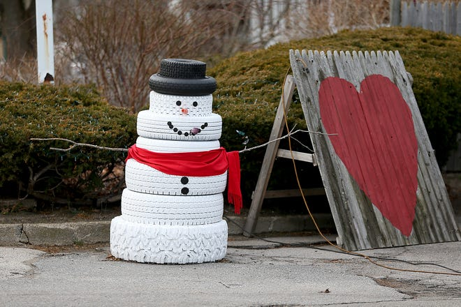 A snowman made out of tires has delighted patrons at the Gulf station on First Parish Road in Scituate.