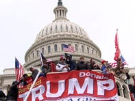 People in the pro-Trump mob take over the steps of the Capitol in Washington, DC, Wednesday, January 6, 2021