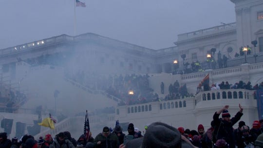 Tear gas fills the air where a pro-Trump mob took over the steps of the Capitol in Washington, DC, Wednesday, January 6, 2021