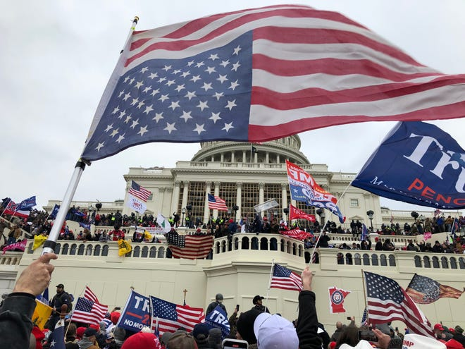 Rioters stand on the west front of the U.S. Capitol building to protest the election certification of President-elect Joe Biden on Jan. 6 in Washington D.C.