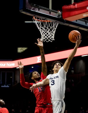 """Freshman Colby Jones' Xavier career began by being quarantined in his dorm room with his roomates. """"Watching our team out there playing, it felt good watching them ... doing their thing, but it was kind of sad and frustrating at the same time -- you want to be out there with your guys,"""" he says."""