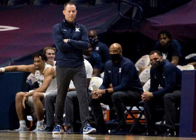 Xavier Musketeers head coach Travis Steele walks the sidelines in the second half of the NCAA men's basketball game on Wednesday, Jan. 6, 2021 at Xavier University in Cincinnati. Xavier defeated St. John's 69-61.