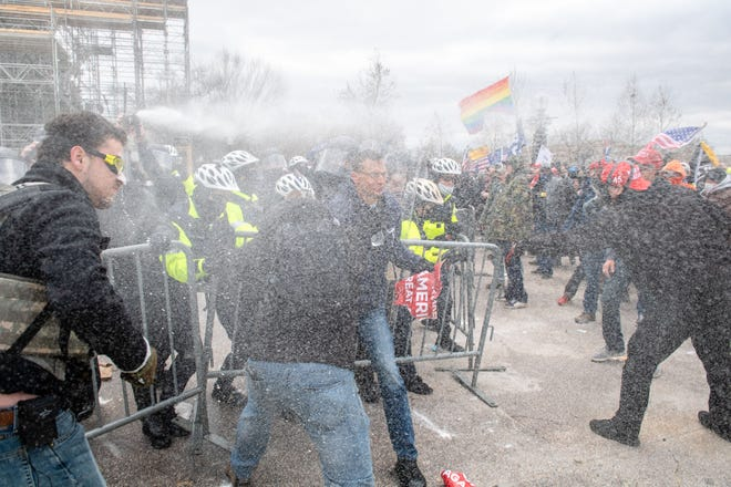 Police and protesters clash at Wednesday the U.S. Capitol.