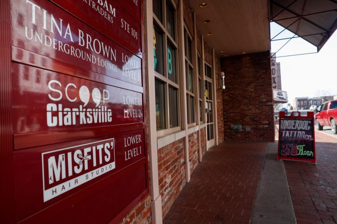 A sign on the side of the building at 110 Franklin advertises the location of the Scoop Clarksville offices, one of many businesses owned by Jason Steen, as seen in downtown Clarksville, Tenn., on Wednesday, Jan. 6, 2021.