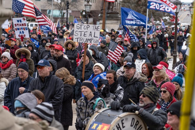 Trump supporters gather outside of Michigan's State Capitol building in Lansing on  January 6, 2021.