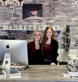 Nikki Pedigo, left, and daughter Maggie Simmons operate Market Street boutiques in two locations, including De Pere.