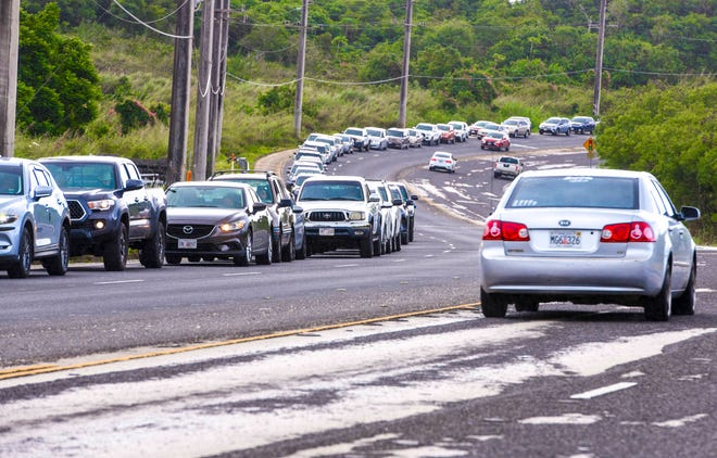 Traffic backs up on Route 3 in Dededo as residents wait in line hoping to receive a dose ot the Pfizer-BioNTech COVID-19 vaccine at a  Department of Public Health and Social Services' temporary vaccination clinic at Okkodo High School in Dededo Thursday, Jan. 7, 2021.