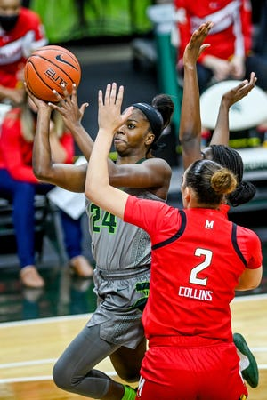 Michigan State's Nia Clouden, left, scores on a layup as Maryland's Mimi Collins defends during the first quarter on Thursday, Jan. 7, 2021, at the Breslin Center in East Lansing.