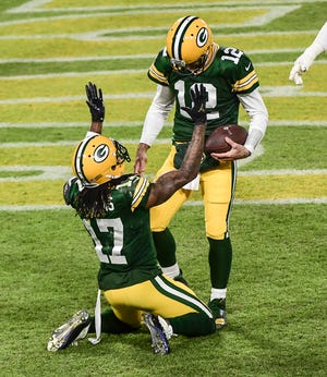 Green Bay Packers wide receiver Davante Adams (17) celebrates with quarterback Aaron Rodgers (12) after scoring a touchdown in the third quarter at Lambeau Field on Dec 6, 2020; Green Bay, Wis.