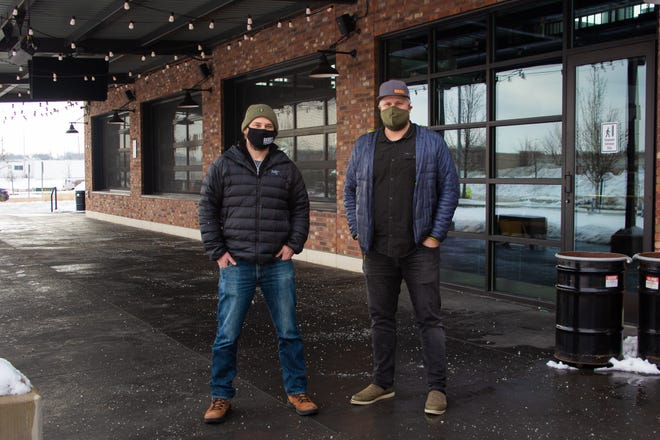 Good City Brewing founders David Dupee and Dan Katt stand in front of the former AVB Social space where they will open their latest location