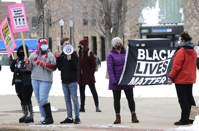 People participate in a Black Lives Matter protest Thursday at Opera House Square in downtown Oshkosh.