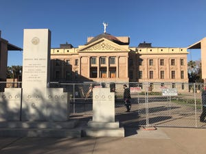 The Arizona Capitol building in Phoenix is fenced off on Jan. 7, 2021.
