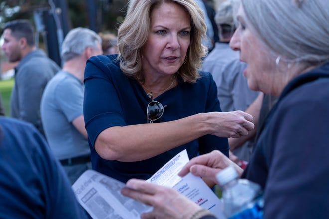 Arizona GOP Chairwoman Kelli Ward attends a rally to protest election results and show support for President Donald Trump at the Arizona Capitol in Phoenix on Jan. 6, 2021.
